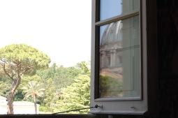 st-peters-reflected-in-window-in-vatican