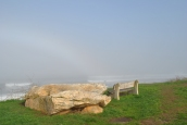 Narragansett foggy shore with rock and bench